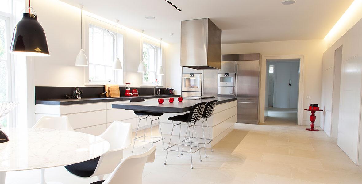 Sleek Studio One style kitchen with black granite counter tops