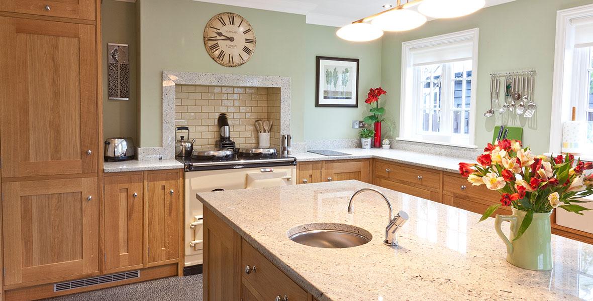 Oak shaker kitchen with custom oven extractor