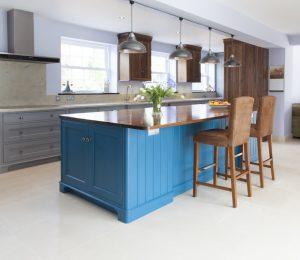 Blue kitchen island with varnished oak top